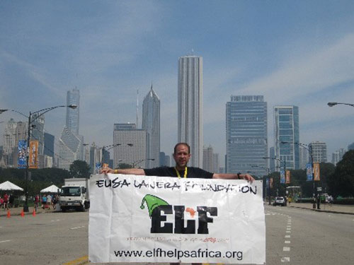 JC holding up ELF banner in the middle of the Chicago streets!